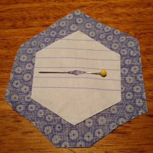 "2.5"" hexagon template with fabric"